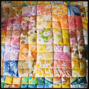 Vintage and retro quilted patchwork baby blanket