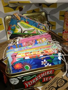 Purses and mini make-up bags made using vintage and retro fabrics